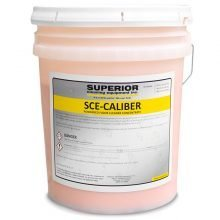 Caliber Floor Cleaner Powder, Pink in a transparent 5 gallon bucket