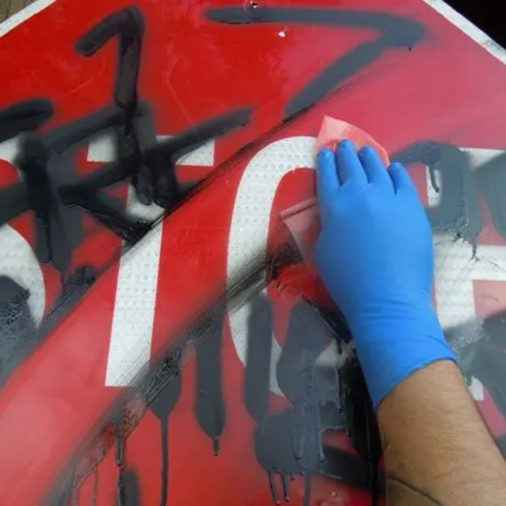 Graffiti Safewipes in action, Removing Stop Sign Graffiti